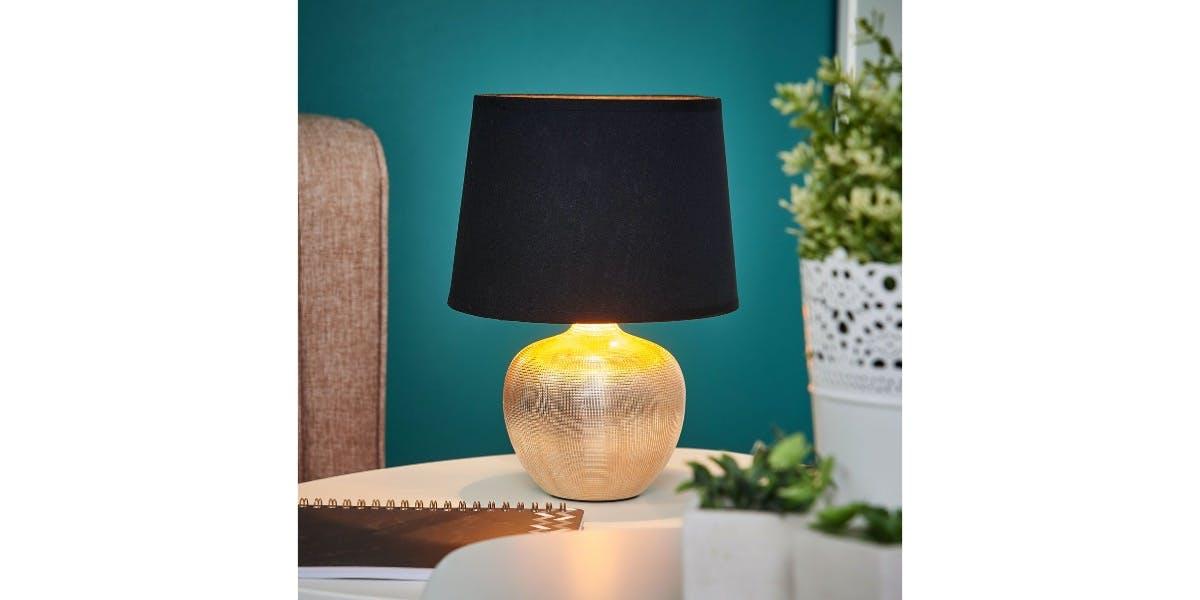 Schwarz-rosegoldene Tischlampe